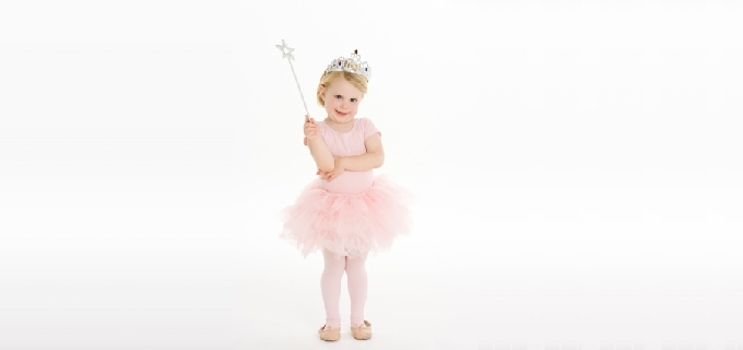 Little Girl Dressed As Fairy Against White Background